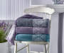 Lavender Gray Jacquard Fringe Bath Towel Lifestyle Image Towels Stacked on Chair Front View