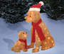 Light Up Fluffy Dogs 2 piece set with big dog wearing a santa hat and puppy wearing a scarf front view in outdoor setting environment image
