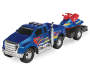 Loaded Ridez Blue Ford F 650 Super Duty Truck and Watercraft Out of Package Silo Image