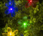 Multi Color Flower Solar Light Set 20 Count Lifestyle Front View Lights on