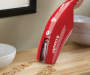 Red Express V6 Hand Vacuum on Counter Room View