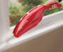 Red Express V6 Hand Vacuum on Windowsill Room View