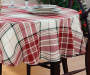 Red Green and White Cozy Plaid Round Tablecloth 60 Inches On Table with Dinnerware Room Environment Lifestyle Image