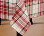 Red Green and White Cozy Plaid Tablecloth 60 Inches by 102 Inches On Table with Dinnerware Lifestyle Image