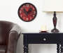 Red Rooster Clock 12 Inches in Room with Pub Chair and Side Table Lifestyle Image