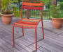 Red Slat Wood and Steel Patio Dining Chairs 4 Pack environment