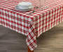 Red White and Green Plaid Fabric Tablecloth 52 inches x 70 inches On table with glassware