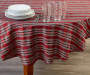 Red and Green Plaid Fabric Round Tablecloth 60 inches On table with glassware