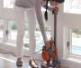 Rocket Ultra Light Stick Vacuum Baseboard Demo with Model Lifestyle Image