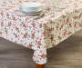 Skating Reindeer PEVA Tablecloth on table with glass ware