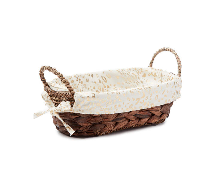 Small Brown Water Hyacinth Oval Bin with Cheetah Print Liner silo angled