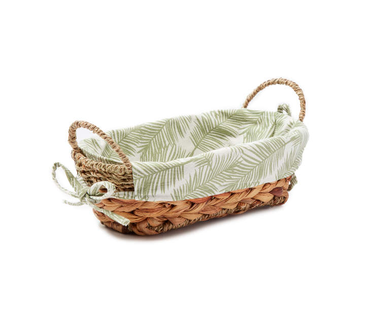Small Natural Water Hyacinth Oval Bin with Palm Leaf Liner silo angled