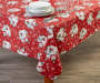 Snowman Friends PEVA Tablecloth on table with dishes and glassware