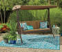 Sonoma Resin Wicker 3 Person Canopy Swing Outdoor Setting Lifestyle Image