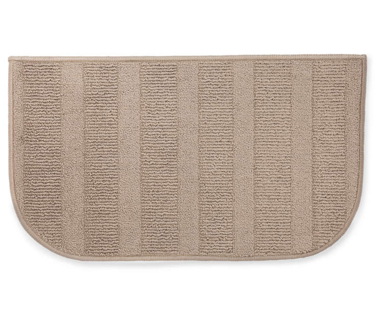 Tan accent rug 18 inches by 30 inches  silo front