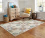 Tara Ivory Area Rug 5 Feet 3 Inches by 7 Feet 6 Inches with Chair Lifestyle Image