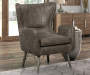 Taupe Faux Leather Modern Accent Chair Front Angled View In A Living Room Setting With Accent Tables And Geometric Rug Lifestyle Image