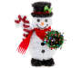 Tinsel crafted snowman wearing a black top hat, red scarf and black shoes carrying an ornament wreath and candy cane front view silo image