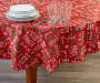 Typography and Holly PEVA Round Tablecloth on table with glasses and dishes