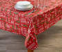 Typography and Holly PEVA Tablecloth on table with glasses and dishes