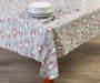 Winter Gnomes PEVA Tablecloth on table with glasses and dishes